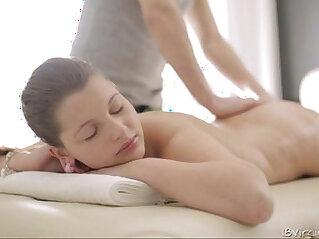 Sexy Nina lays boobs down on the massage